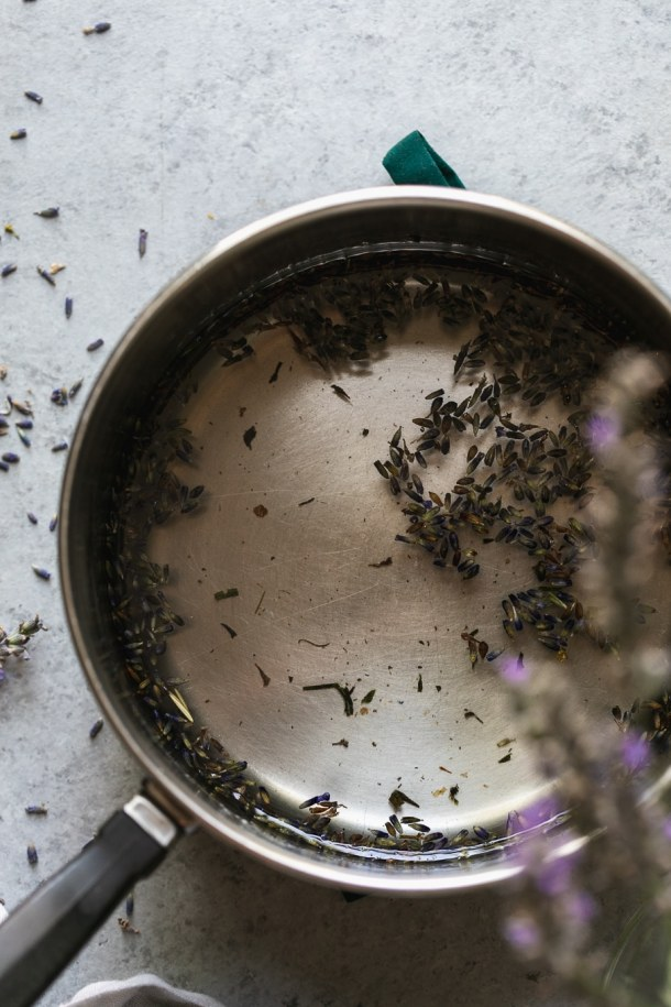 Overhead shot of a saucepan filled with lavender simple syrup