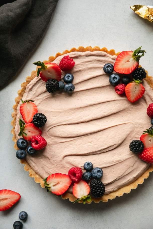 Overhead shot of a berry cheesecake tart