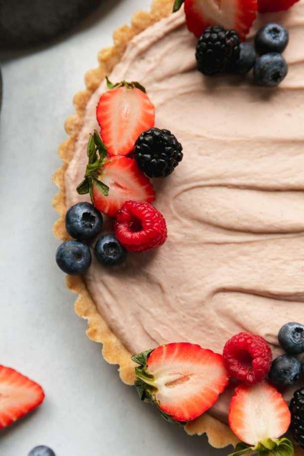Overhead close up shot of a berry cheesecake tart