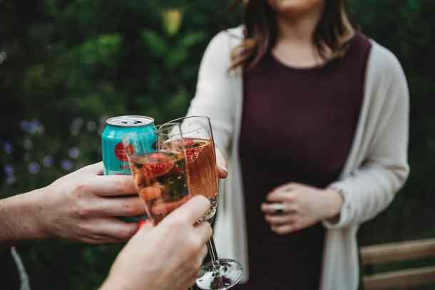 Shot of 3 people saying cheers