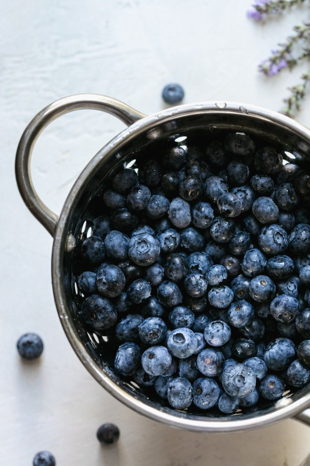Overhead shot of a colander filled with blueberries