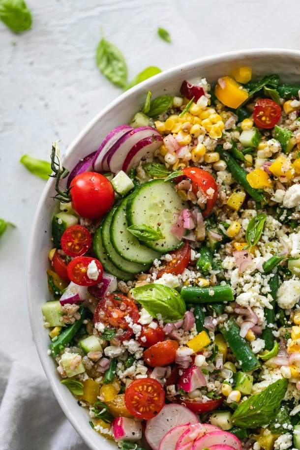 Overhead close up shot of a colorful grain salad