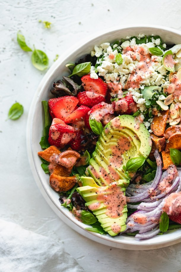 Overhead shot of a colorful salad with roasted strawberry poppyseed vinaigrette
