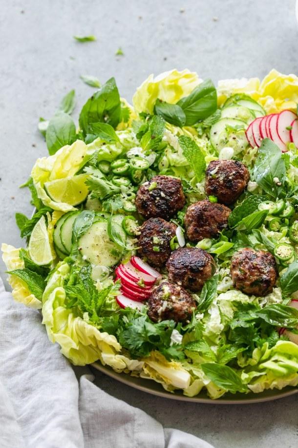 Overhead shot of a vietnamese salad with pork meatballs