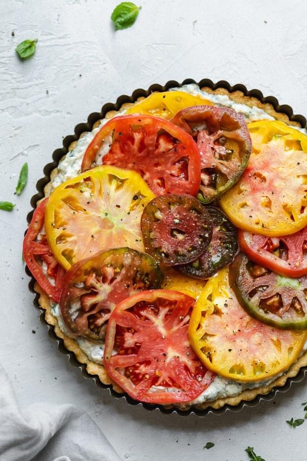 Overhead shot of an heirloom tomato tart before baking