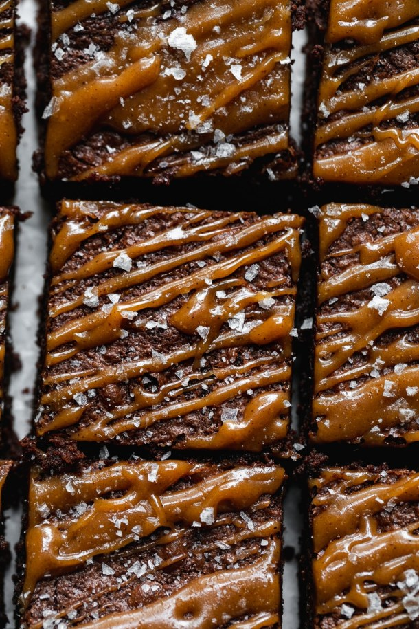 Super close up shot of brownies drizzled with chai salted caramel and sea salt