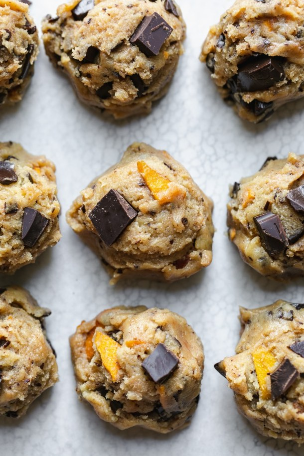 Overhead close up shot of cookie dough balls on a baking sheet