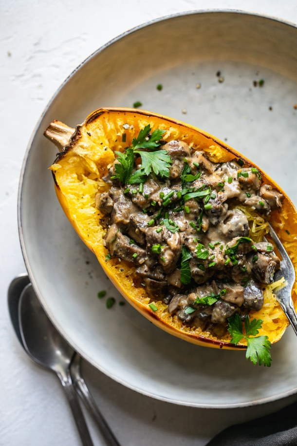 Overhead shot of a creamy mushroom spaghetti squash boat with a fork digging in