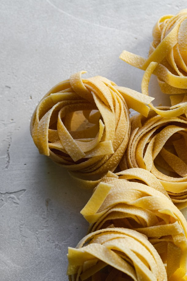 Close up shot of dried nests of tagliatelle pasta