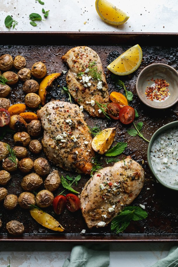 Overhead shot of a sheet pan with baby potatoes and chicken