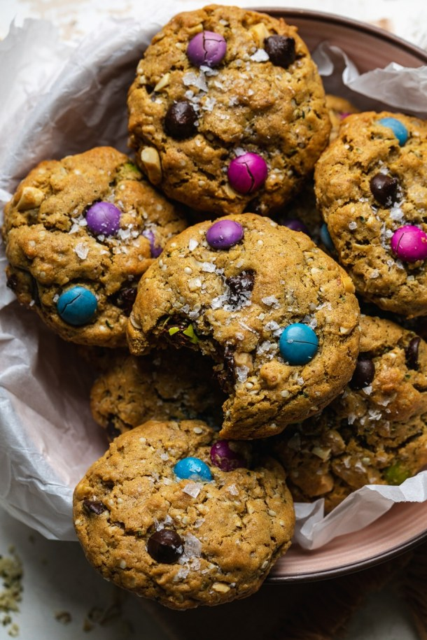 Close up shot of a pile of monster cookies with a bite taken out on top
