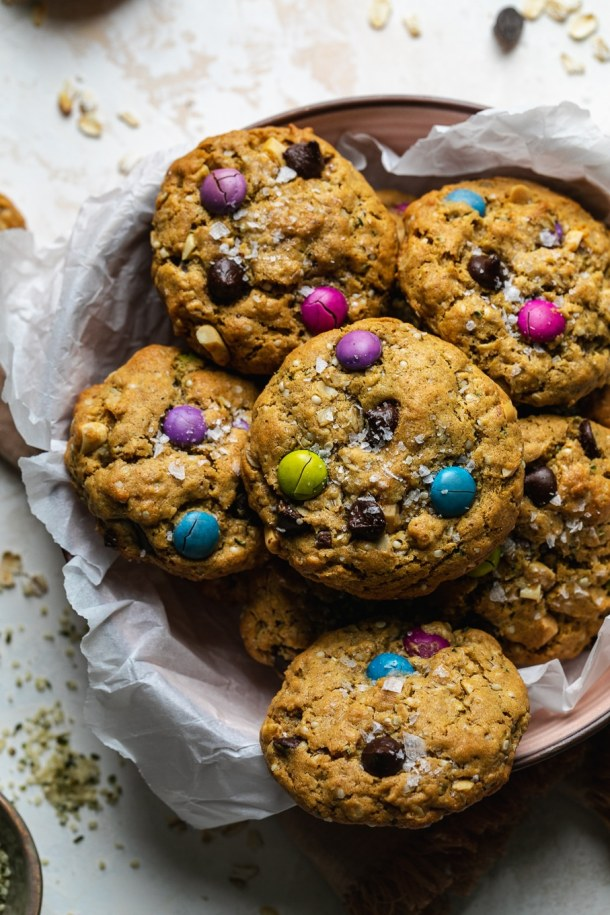 Overhead close up shot of a bowl of cookies filled with colorful candy coated chocolate pieces