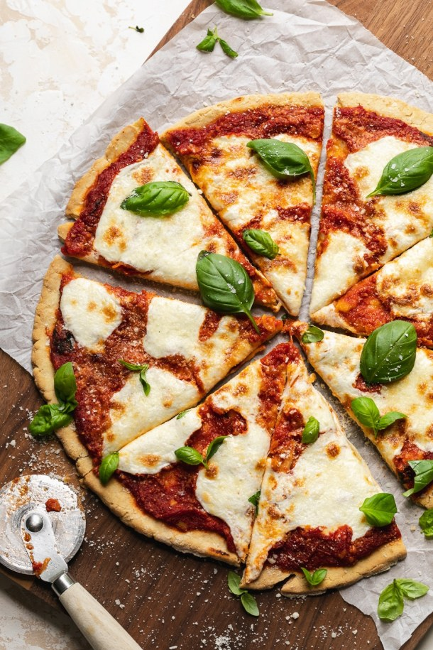 Overhead shot of a gluten free margherita pizza cut into slices
