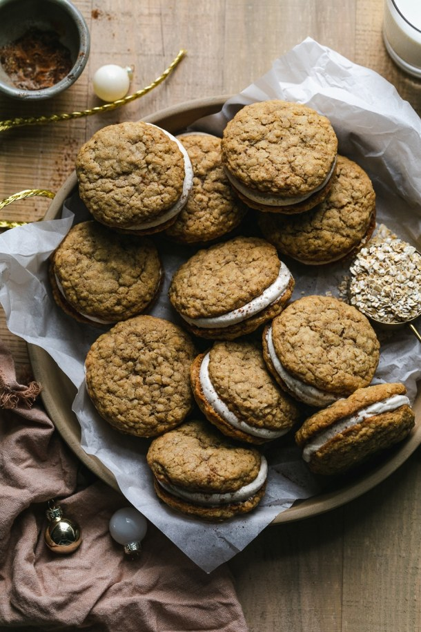 Overhead shot of oatmeal sandwich cookies piled on a plate