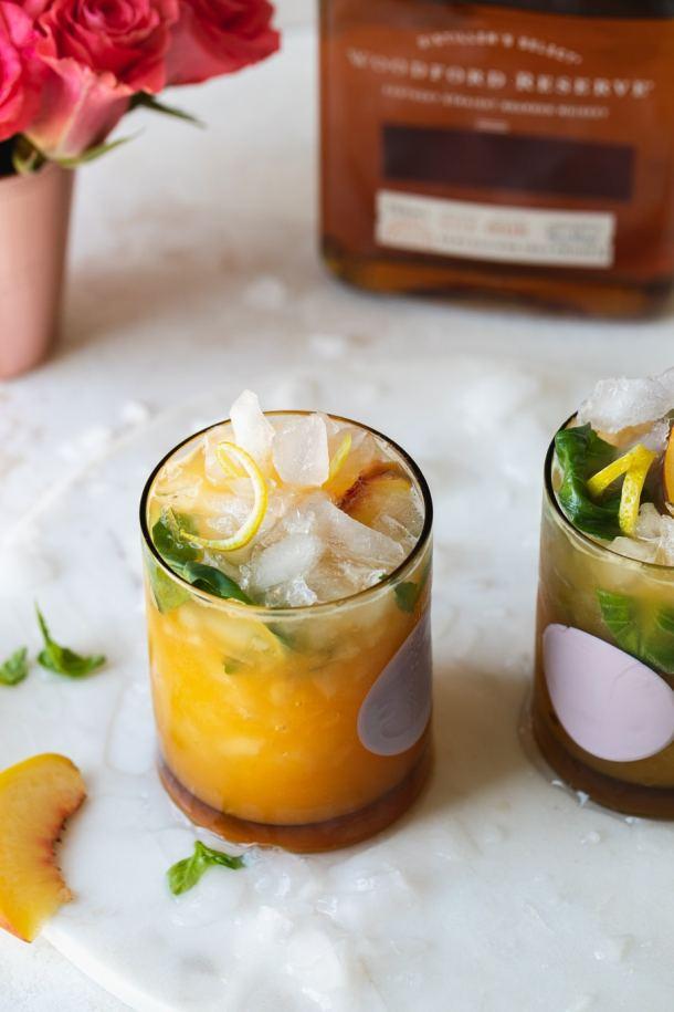 Close up shot of a peach basil cocktail