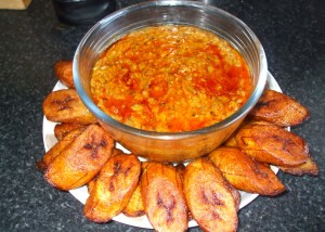 Riped fried plantain with black eyed beans stew [red-red]