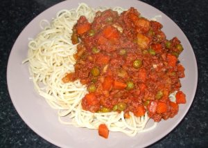 Spaghetti with corned beef and vegetables stew