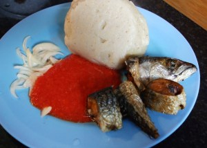 banku and hot pepper with fried mackerel