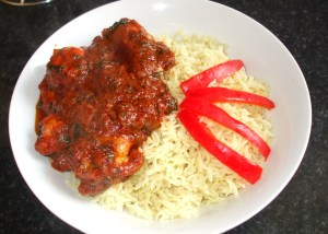 cooked curry rice with tandoori chicken curry