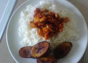 plain rice with fried plantain and egg stew
