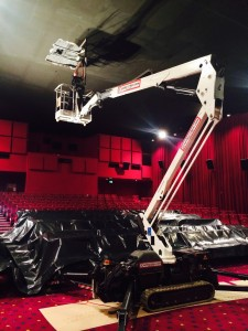 Cherry picker working in village cinemas