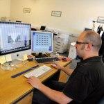 Skilled mac operator working on some pre press work