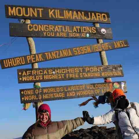 mom and daughter at top of mount kilimanjaro