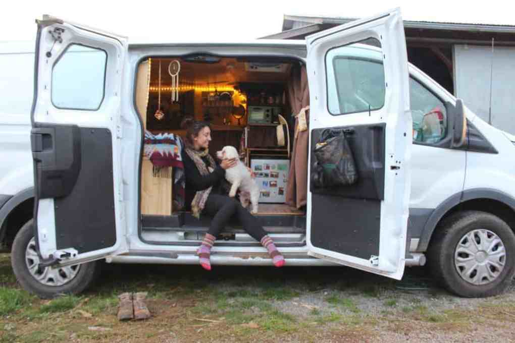 girl and dog living in a van
