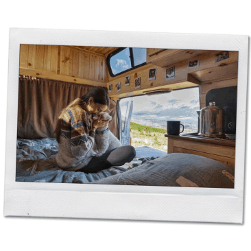 girl and her dog in converted camper van