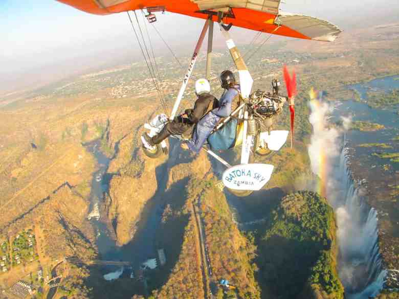 flying in a microlight over victoria falls in Zambia top travel bucket list item