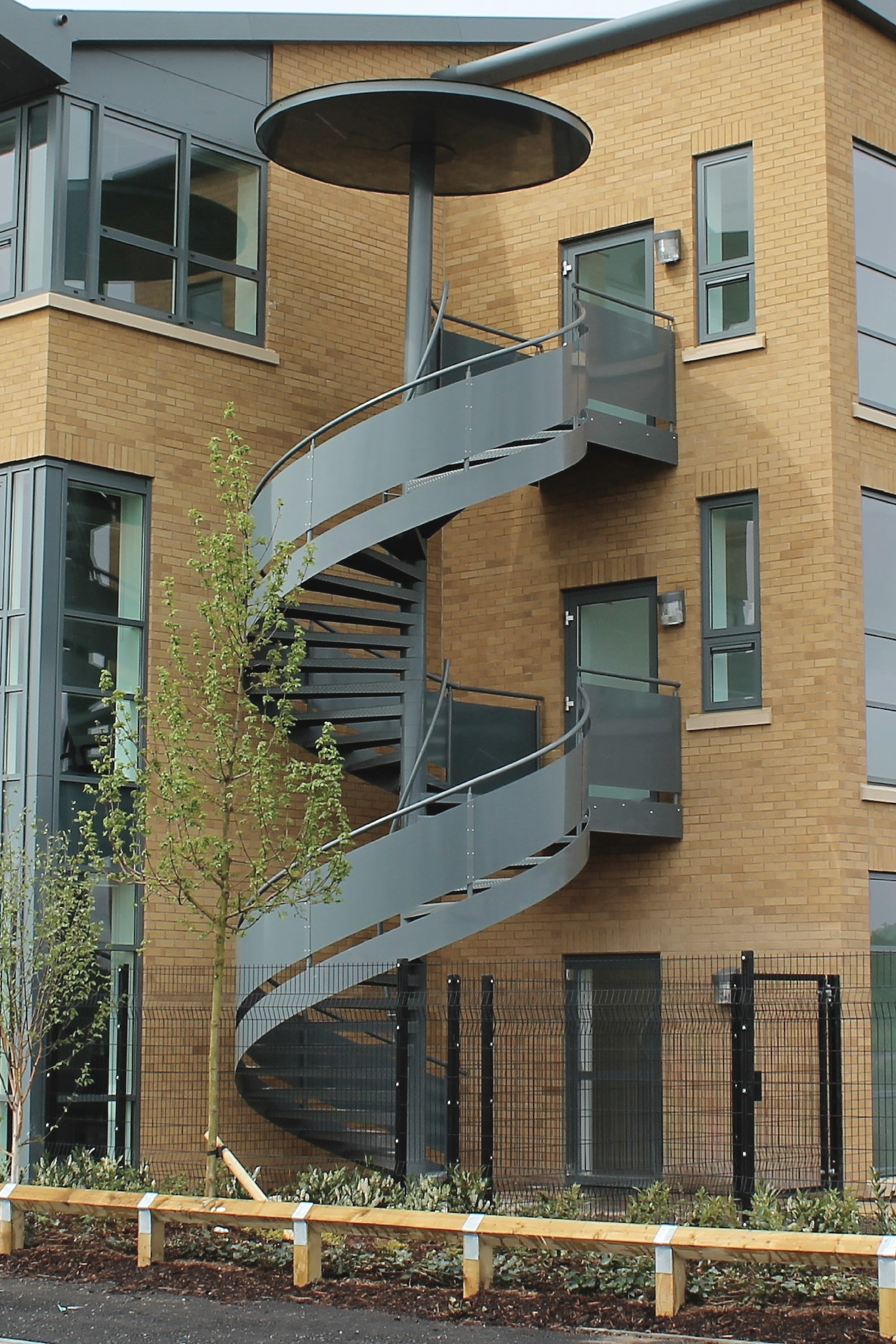 Spiral Fire Escape Stairs External Internal Escape Stairs | External Metal Fire Escape Stairs | Metal Railings | Stock Photo | Stair Railing | External Spiral Staircase | Fire Safety