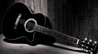 Black guitar, photo by juliana luz