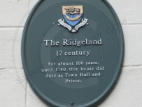 Heritage plaque on the side of the building