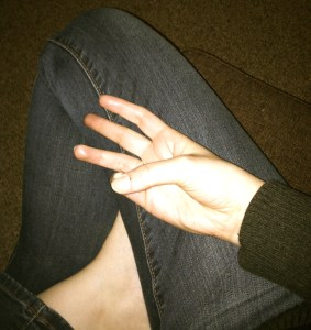 For women: Place your right hand in your lap with your thumb touching your little finger. (Men: reverse hands)