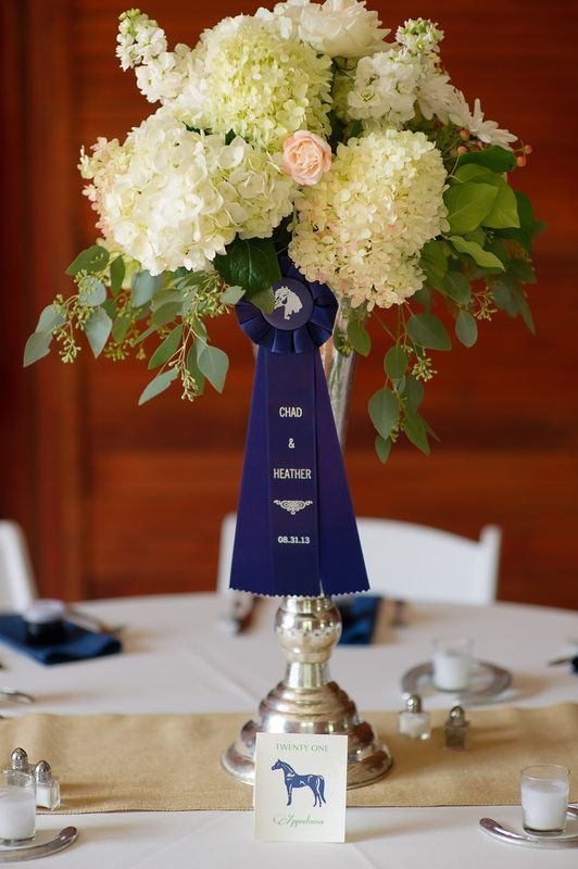 Love this flower arrangement in a horse show trophy with customized ribbon. Perfect for that equestrian wedding!