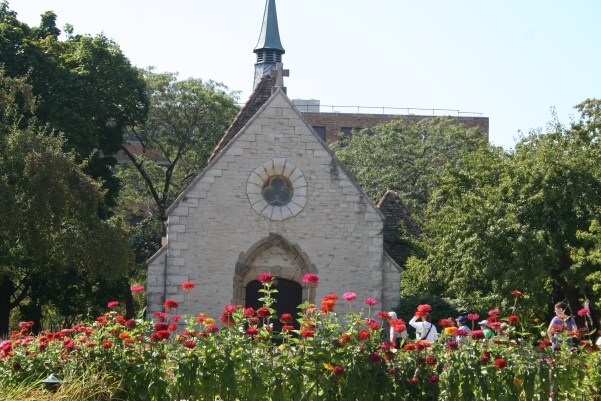 white chapel with flowers in front