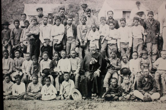 Father Damien amid the community at the Kalawao leper colony on Molokai Island (photo from Father Damien's shrine)