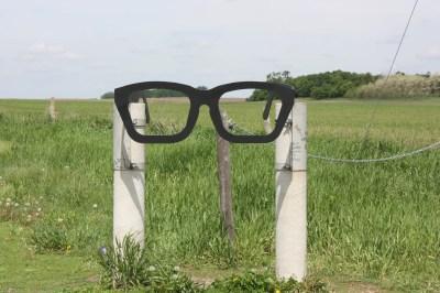 Buddy Holly eyeglasses sign
