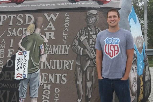 Bubba Sorensen stands next to the original Freedom Rock near Menlo, Iowa. (Bob Sessions photo)