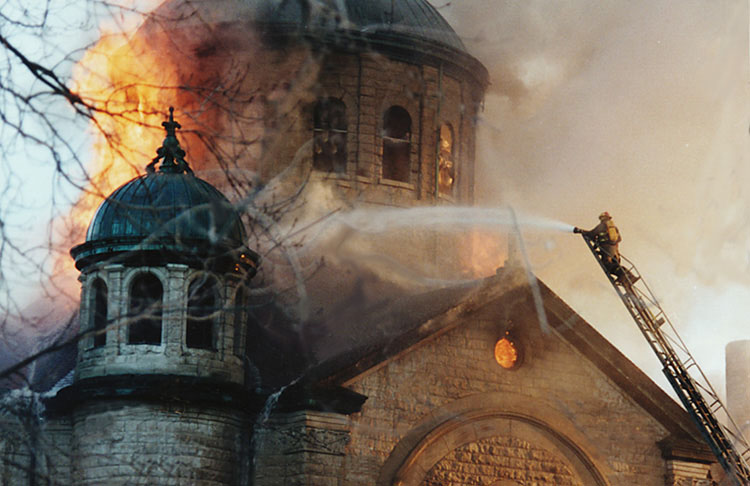 The fire in 1995 destroyed virtually everything but the walls of the church. (photo courtesy of Saints Center)