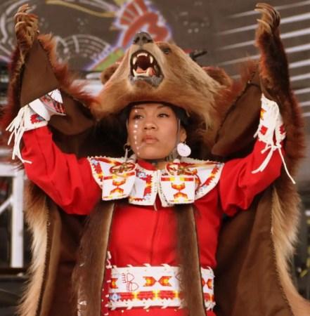 woman wearing bear costume, woman with bear skin