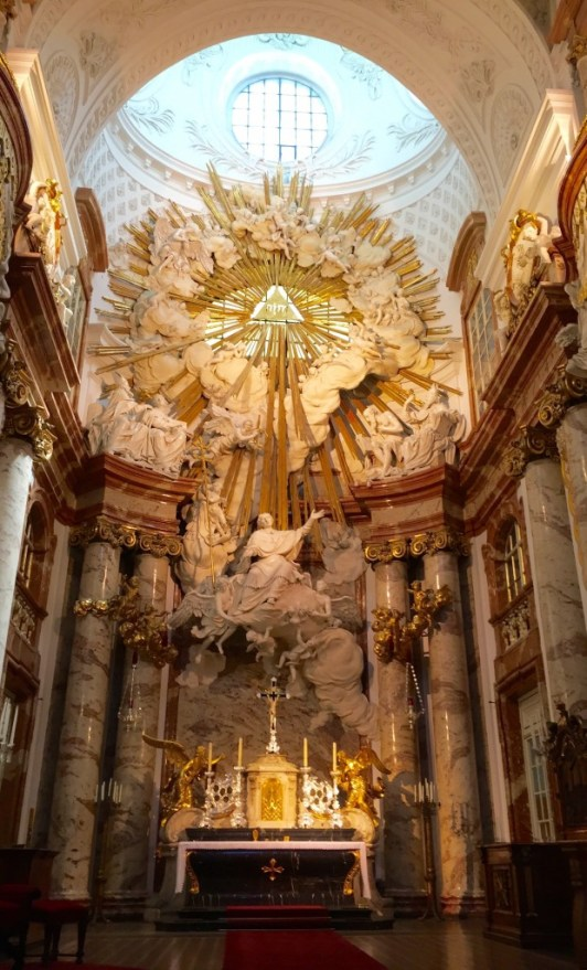 The Baroque interior of Karlskirche directs the eye upwards, towards the light. (Lori Erickson photo)