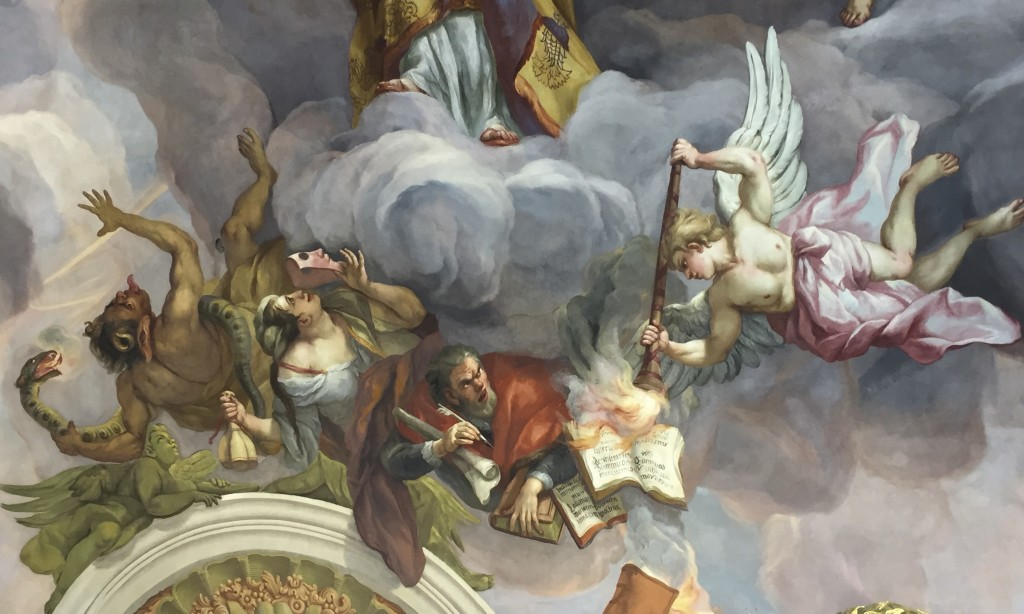 A fresco in Karlskirche shows Martin Luther being banished to Hell. (Lori Erickson photo)