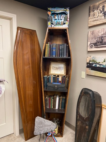 bookcase in a coffin, unusual death artifacts