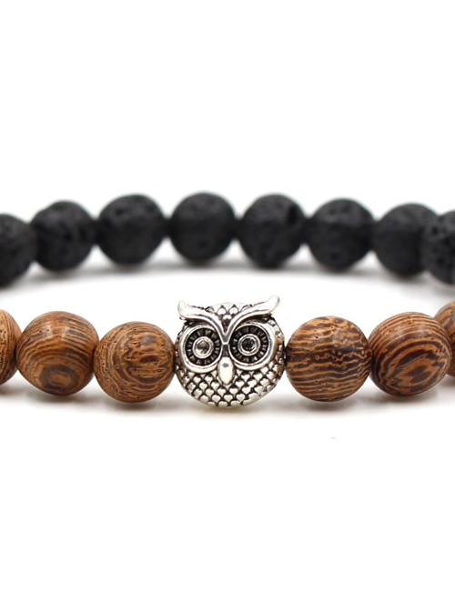 Boeddhistische zwarte lavasteen en hout uil armband foto 2