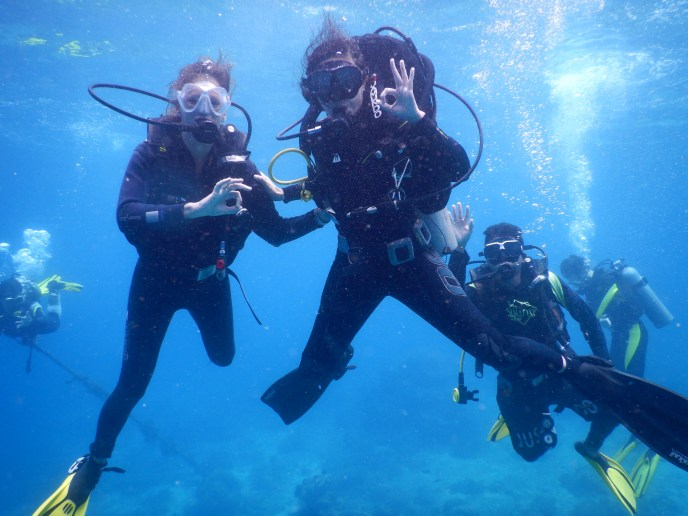 enjoying scuba diving on Apo Island