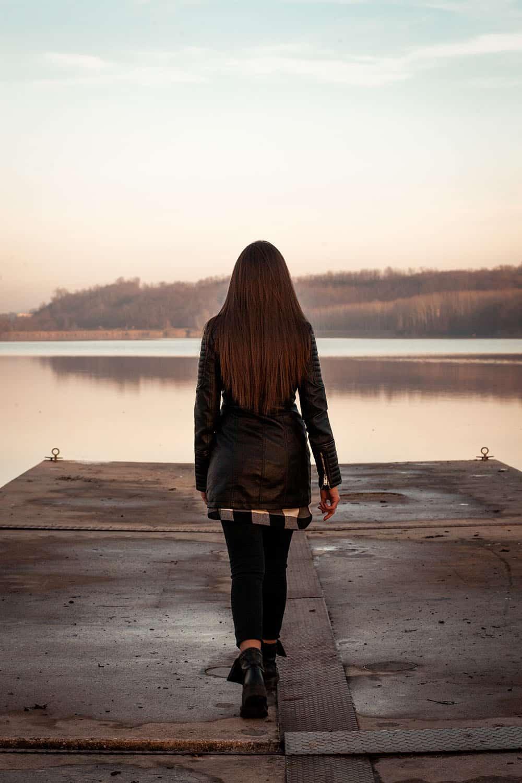 Lonely Girl Walking On The Pier Splitshire