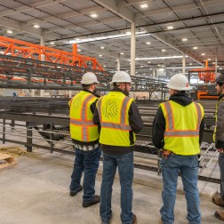 Workers looking at equipment in plant