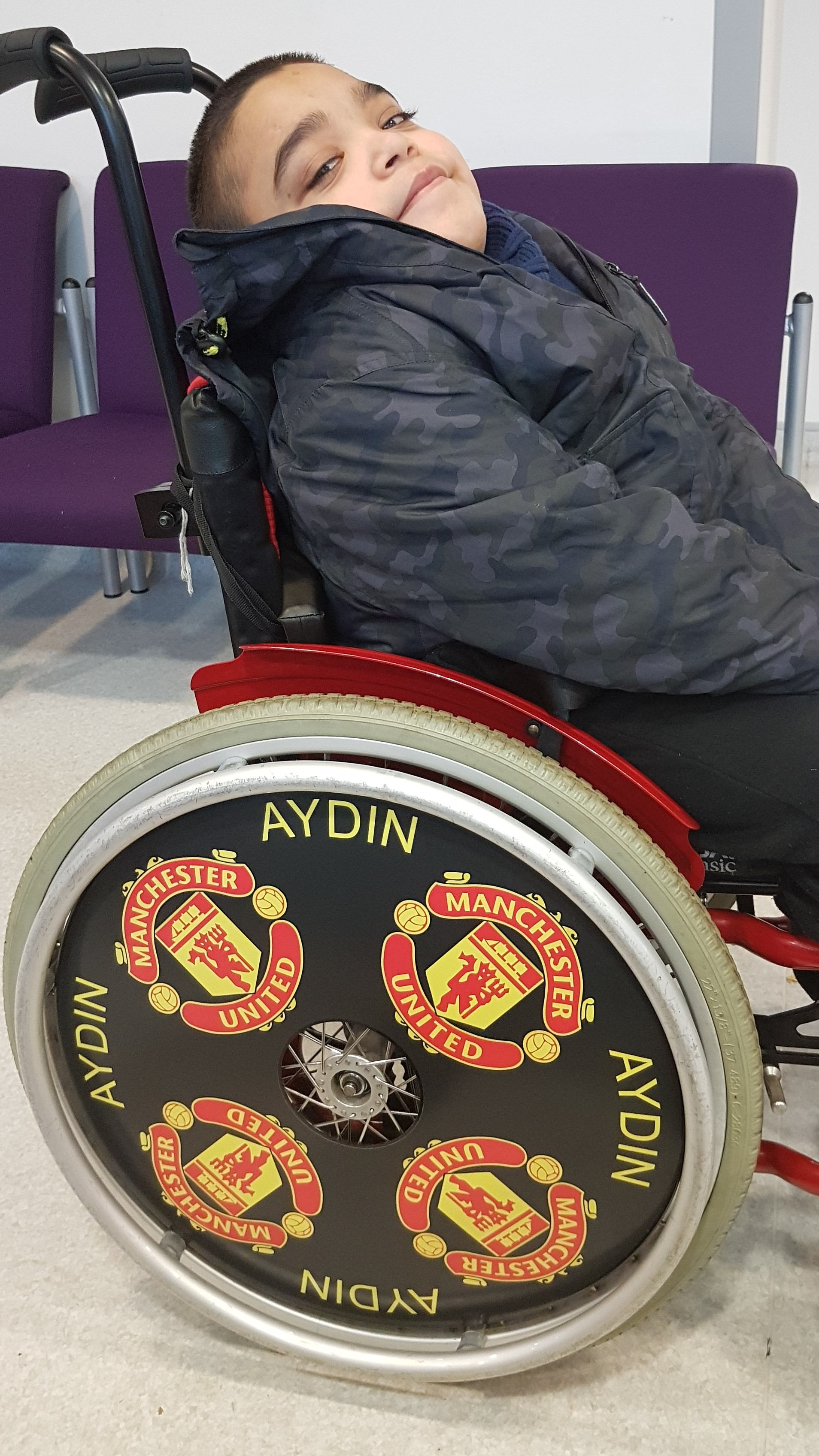 Aydin with his Manchester United SpokeGuards wheel covers