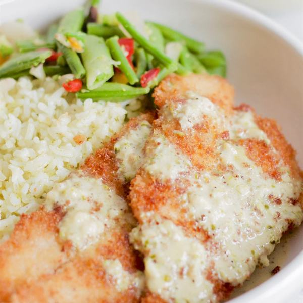 Panko Crusted Fish with Creamy Garlic Pesto Sauce | www.SpoonfulOfButter.com